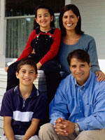 Photo of a Hispanic family (daughter, mother, son, father).