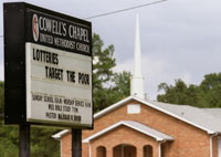 A church sign reading 'Lotteries Target the Poor'